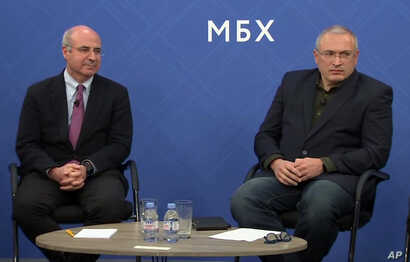 In this image made from video, Kremlin critic Mikhail Khodorkovsky, right, and financier William Browder attend a joint press conference in London, Nov. 20, 2018. They and other Kremlin foes have warned against naming a top Russian police official to...