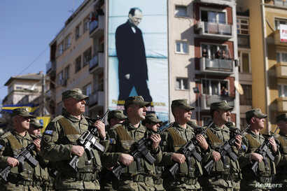 Members of Kosovo Security Forces march during a celebration marking the eighth anniversary of Kosovo's declaration of independence from Serbia, in Pristina ,Feb. 17, 2016.