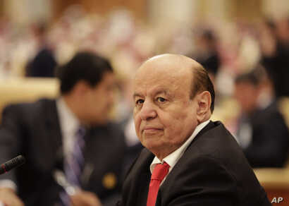 FILE -  the President of Yemen Abed Rabbo Mansour Hadi, participates in a summit of Arab and South American leaders in Riyadh, Saudi Arabia.