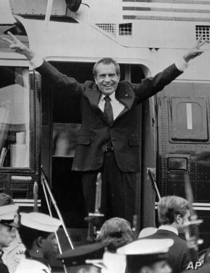 Richard Nixon says goodbye to members of his staff outside the White House as he boards a helicopter for Andrews Air Force Base after resigning the Presidency, August 9, 1974.