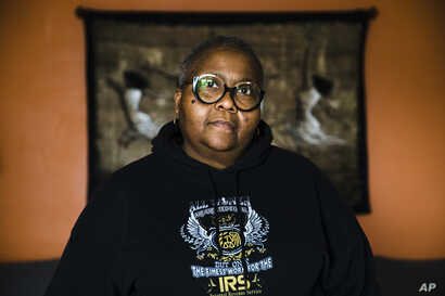 Nora Brooks, a furloughed customer service representative for the Internal Revenue Service, poses for a photograph at her home in Philadelphia, Pennsylvania, Jan. 3, 2019. Brooks worries about whether she will need to seek a second job.