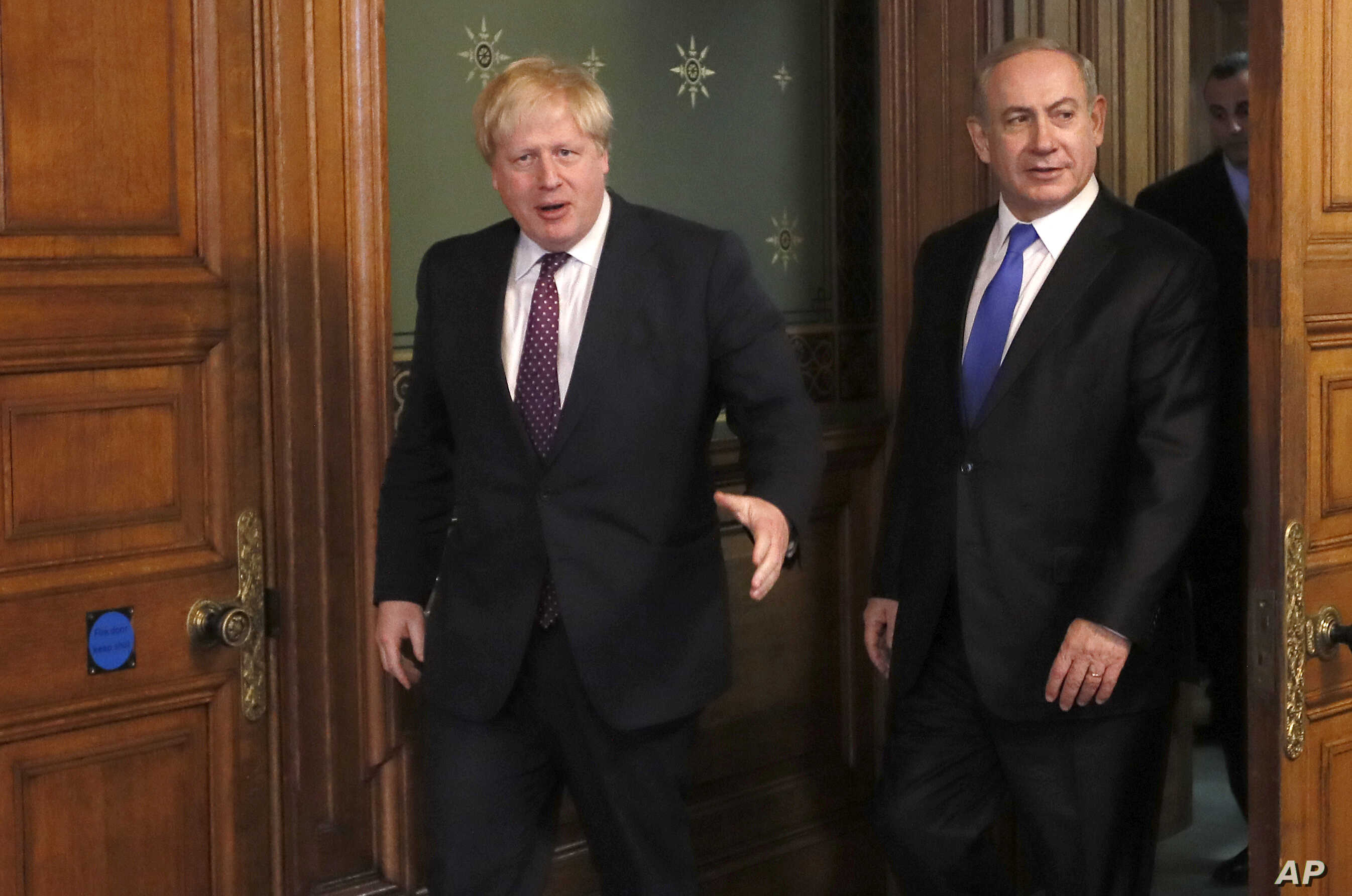 Britain's Foreign Secretary Boris Johnson, left, greets Prime Minister Benjamin Netanyahu of Israel at the Foreign Office in London, Feb. 6, 2017.