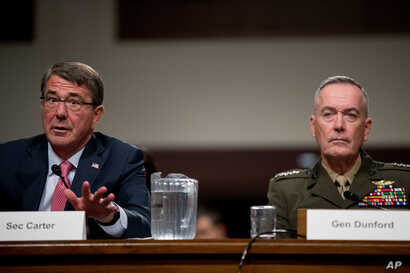 Defense Secretary Ash Carter, left, accompanied by Joint Chiefs Chairman Gen. Joseph Dunford, right, testifies on Capitol Hill in Washington, Sept. 22, 2016, before the Senate Armed Services Committee hearing.