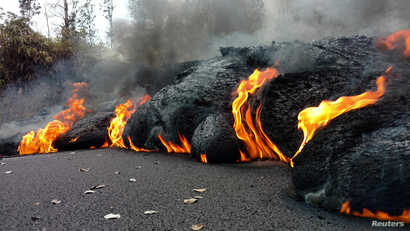A lava flow is seen on a road in Pahoa, Hawaii, U.S.