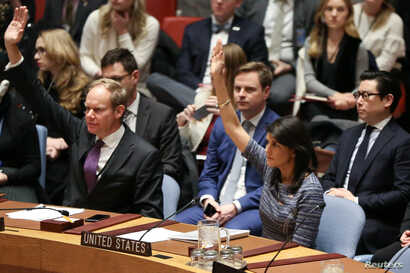 U.S. Ambassador to the United Nations Nikki Haley votes among other members of the United Nations Security Council to impose new sanctions on North Korea, at U.N. headquarters in New York, Dec. 22, 2017.