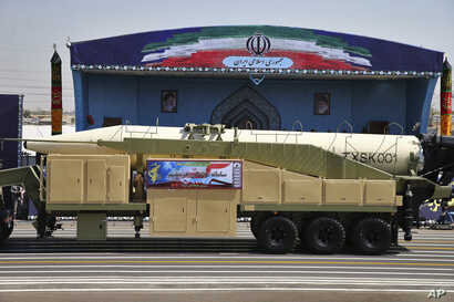 Iran's Khoramshahr missile is displayed by the Revolutionary Guard during a military parade marking the 37th anniversary of Iraq's 1980 invasion of Iran, in front of the shrine of late revolutionary founder Ayatollah Khomeini, near Tehran, Iran, Sept...