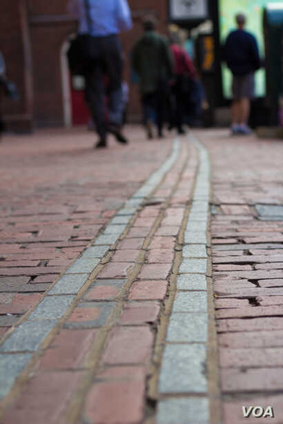The Freedom Trail is a red-lined path leading to 16 historic sites, including the Old South Meeting House.