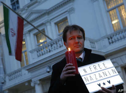 Richard Ratcliffe husband of imprisoned charity worker Nazanin Zaghari-Ratcliffe, poses for the media during an Amnesty International led vigil outside the Iranian Embassy in London, Jan. 16, 2017.