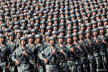 Soldiers of China's People's Liberation Army (PLA) get ready for the military parade to commemorate the 90th anniversary of the foundation of the army at Zhurihe military training base in Inner Mongolia Autonomous Region, China, July 30, 2017.