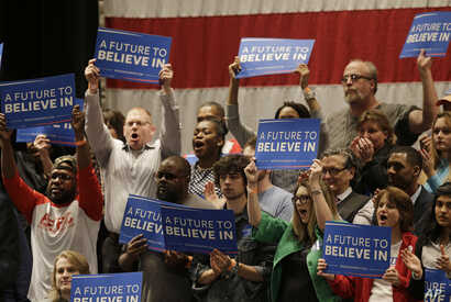 Supporters cheer as Democratic presidential candidate, Sen. Bernie Sanders, I-Vt, speaks at a campaign rally at the Akron Civic Theatre, March 14, 2016, in Akron, Ohio.