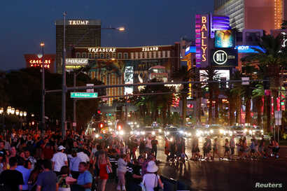 Tourists enjoy the Las Vegas Strip as they visit Las Vegas, Nevada, Aug. 27, 2018.