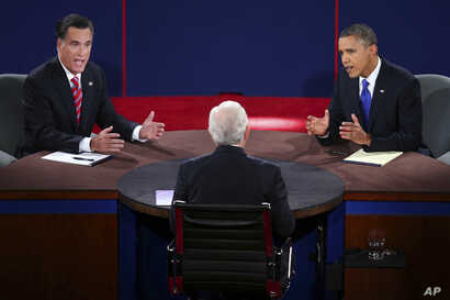 Republican presidential nominee Mitt Romney and President Obama answer a question during the third presidential debate focused mostly on the Middle East, October 22