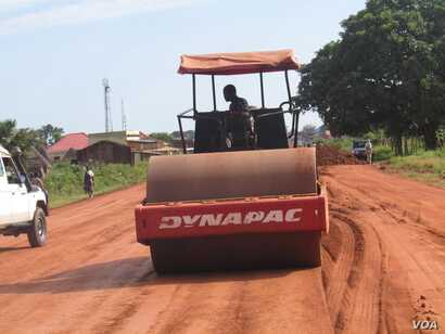 A worker flattens a mix of gravel and dirt on the main road connecting the capital of Warrap state in South Sudan to the town of Tharkueng, 30 kilometers away. State officials began repairing the road in Sept. 2014.