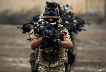 "Members of Iraq's Rapid Response military unit take part in a ""counter-terrorism"" training at a military base inside Baghdad International Airport on December 4, 2018."