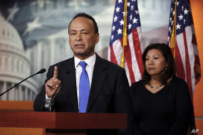Rep. Luis Gutierrez, D-IIli, left, with Rep. Norma Torres, D-Calif., speaks during a news conference about the court-ordered deadline to reunify immigrant families who were separated at the border, Wednesday, July 25, 2018, on Capitol Hill in Washing...