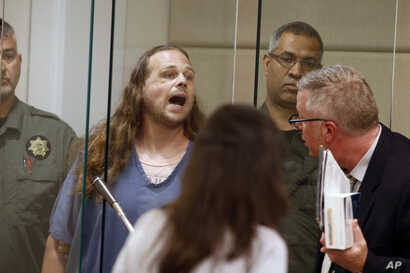 Jeremy Joseph Christian shouts as he is arraigned in Multnomah County Circuit Court in Portland, Ore., May 30, 2017.