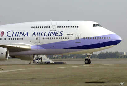 FILE - A China Airlines Boeing 747-400 sits on the tarmac at the Chiang Kai-shek International Airport in Taoyuan, Taiwan.