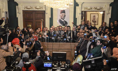 Hani Sarie-Eldin, member of the Supreme Committee of the Wafd Party, speaks to the press at the headquarters of the party following a meeting, in the capital Cairo, on Jan. 27, 2018.