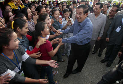 Cambodia's Prime Minister Hun Sen greets garment workers during a visit to the Phnom Penh Special Economic Zone on  the outskirts of Phnom Penh, Cambodia, Aug. 23, 2017. The U.S. State Department expressed concern Wednesday about what it said it was ...