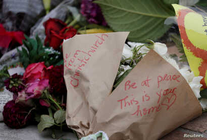 Flowers are seen at a memorial as a tribute to victims of the mosque attacks, near a police line outside Masjid Al Noor in Christchurch, New Zealand, March 16, 2019.