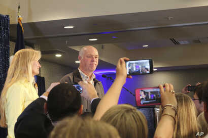 Republican Greg Gianforte greets supporters at a hotel ballroom after winning Montana's sole congressional seat, May 25, 2017, in Bozeman, Mont. In his speech, Gianforte apologized for a altercation at his campaign headquarters with a reporter on the...