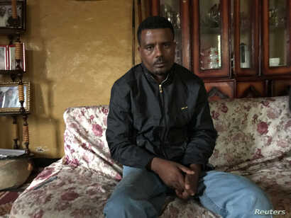 FILE - Recently released from prison, Ethiopian torture survivor and former political prisoner Keyfalew Tefera, 33, poses during a Reuters interview in Addis Ababa, Ethiopia, July 17, 2018.