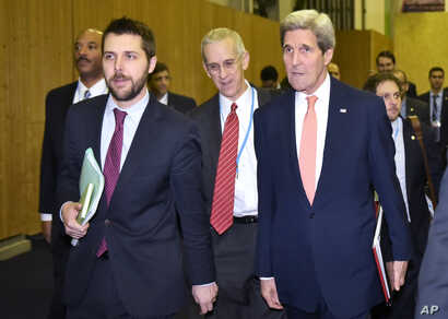 U.S. Secretary of State John Kerry, right, walks with White House senior adviser Brian Deese, left, to meet with French Foreign Minister Laurent Fabius during the climate change conference at Le Bourget, France, Dec. 10, 2015.