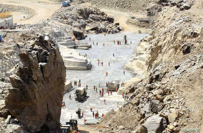 Workers continue building Ethiopia's $4.7 billion Grand Renaissance Dam while basin neighbors argue water rights with Egypt.