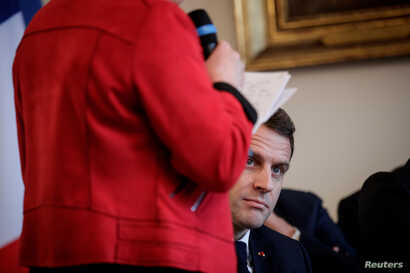 French President Emmanuel Macron attends a meeting with the cities mayors of the Saone-et-Loire department, as part of the 'Great National Debate' designed to find ways to calm social unrest of the Yellow Vests movement, in Autun, Feb. 7, 2019.