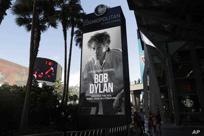 A sign outside of the Cosmopolitan of Las Vegas congratulates Bob Dylan, Oct. 13, 2016, after he won the 2016 Nobel Prize in literature.
