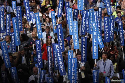 Delegates hold Hillary Clinton signs at the Democratic National Convention in Philadelphia, Pennsylvania, July 28, 2016.