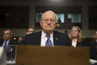 Director of National Intelligence James Clapper arrives for a Senate Armed Services Committee hearing about worldwide threats, on Capitol Hill, Feb. 9, 2016, in Washington.