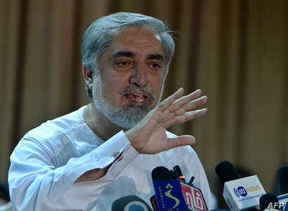 Afghan presidential candidate Abdullah Abdullah speaks at a press conference at his residence in Kabul on July 6, 2014.