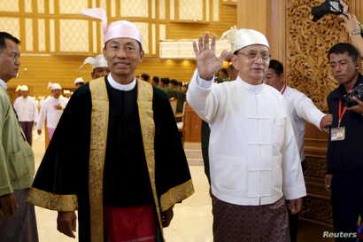 Myanmar's President Thein Sein, right, and speaker of Union Parliament Shwe Mann arrives at the Union Parliament in Naypyitaw, Jan. 28, 2016.