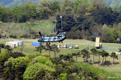 A Terminal High Altitude Area Defense (THAAD) interceptor (right) is seen in Seongju, South Korea, April 26, 2017.