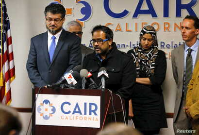 Farhan Khan (C), brother-in-law of San Bernardino shooting suspect Syed Farook, speaks at the Council on American-Islamic Relations during a news conference in Anaheim, California, Dec. 2, 2015.