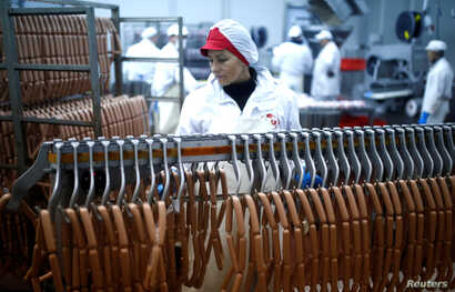 Workers make sausages at Akova Impex Meat Industry Ovako, which makes halal quality certified products, in Sarajevo, Bosnia and Herzegovina, Dec. 2, 2016.