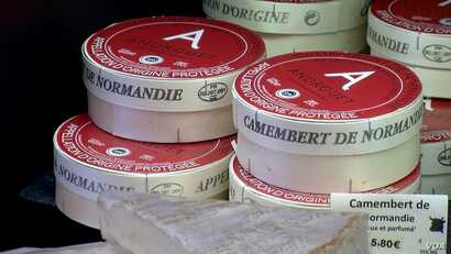 French cheese makers are fighting to preserve AOP labels, like this one for camembert. (L. Bryant/VOA)