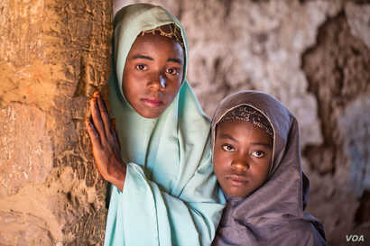 Aisha Amiru (with green hijab) said she and her younger sister look forward to getting married in a few years. (C. Oduah/VOA)
