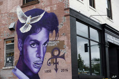 FILE - A mural honoring the late Prince adorns a building in the Uptown area of Minneapolis, Aug 28, 2016.