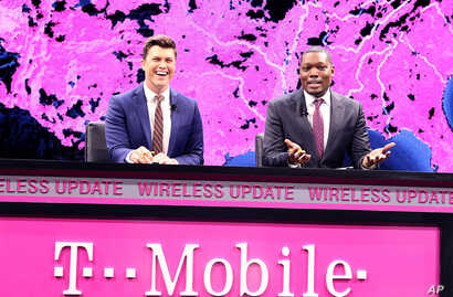 FILE - Saturday Night Live Weekend Update's Colin Jost (left) and Michael Che are seen at a T-Mobile event in Las Vegas, Nevada, Jan. 5, 2017. Saturday Night Live has seen its ratings soar during the presidential campaign as well as after the electio...