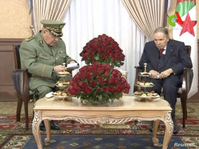 FILE - Algeria's President Abdelaziz Bouteflika meets with Army Chief of Staff Lieutenant General Ahmed Gaid Salah in Algiers, Algeria, in this handout still image taken from a TV footage released on March 11, 2019.