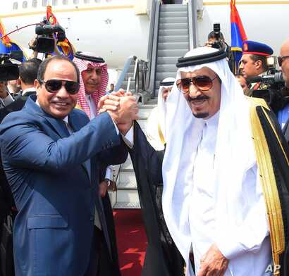 FILE - Egyptian President Abdel-Fattah el-Sissi, left, shakes hands with Saudi Arabia's King Salman before he departs Egypt, April 11, 2016.