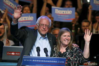 Democratic U.S. presidential candidate Bernie Sanders and his wife, Jane O'Meara Sanders, wave to supporters at a rally in Hollywood in Los Angeles, Oct. 14, 2015.
