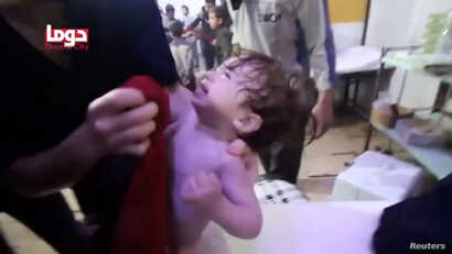 A child cries as they have their face wiped following alleged chemical weapons attack, in what is said to be Douma, Syria in this still image from video obtained by Reuters on April 8, 2018.