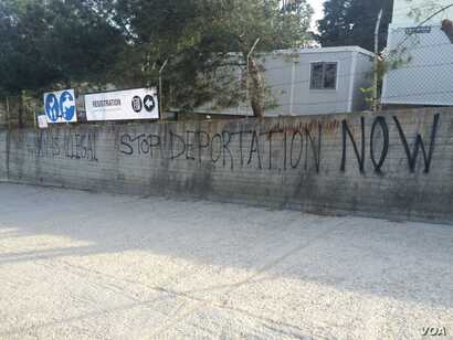 Graffiti outside the refugee camp, now essentially a detention center, in Lesbos, Greece, April 1, 2016. (H. Murdock/VOA)