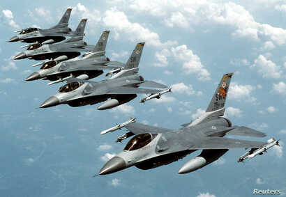 "FILE- Five U.S. Air Force F-16 ""Fighting Falcon"" jets fly in echelon formation over the U.S. en route to an exercise in this undated file photograph."