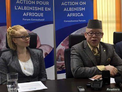 The United Nations' first independent expert on albinism, Ikponwosa Ero, left, and Kenya's first Member of Parliament with albinism, Isaac Mwaura, address the media in Kenya's capital Nairobi, Nov. 16, 2016.