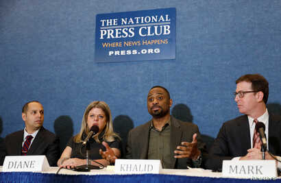 Plaintiffs Diane Gross and Khalid Pitts (2nd R), co-owners of Cork Wine Bar, sit with DC attorneys Scott Rome (L) and Mark Zaid (R) during a news conference at the National Press Club held to announce the filing of a lawsuit against U.S. President Do...