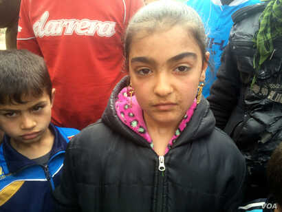 Children like this 12-year-old girl say they developed spots on their skin and respiratory problems after what appear to be homemade chemical weapons fell on their neighborhoods in eastern Mosul, Iraq, March 8, 2017.